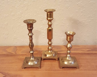 Vintage brass candlesticks.   Set of 3 boho candleholders. One of a kind set.