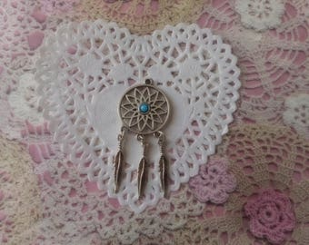 Silver-plated Dreamcatcher charm finely perforated 6.20 cm in height.