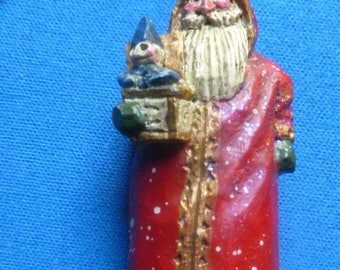 Vintage Pam Schifferl Christmas Santa Ornament Holding a Toy in his Right Arm