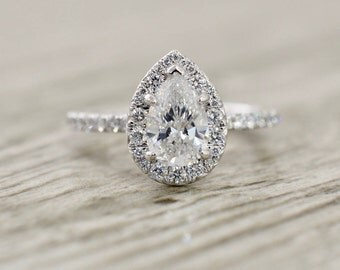 Pear Brilliant in a French Pavé Halo & Stem Engagement Ring in White