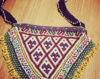 Afghan ethnic beaded bag in triangle.