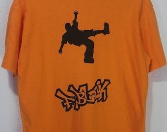 1000 ON SALE Vintage 90s Funky Fresh music Dancer man orange tee shirt