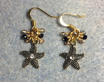 Black and gold enamel and rhinestone starfish charm earrings adorned with tiny dangling black, gold, and clear Chinese crystal beads.