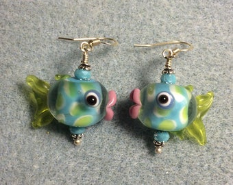 Turquoise with green spots lampwork fish bead earrings adorned with turquoise Chinese crystal beads.