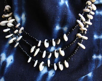 African Cowerie shell multistrand.  Black and white, layered style. Hand made and very wearable.  Urban tribal.
