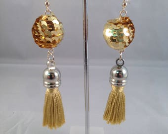 Sparkly gold dangling tassel earrings
