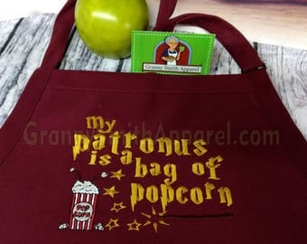 """Patronus Harry Potter bag of popcorn quote 24""""L x 28""""W professional 3 pocket full bib apron. Many colors. Customized in colors requested"""
