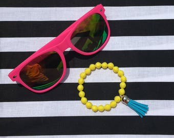 Yellow bead bracelet with blue tassel