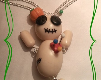 Voodoo doll hand made necklace