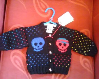 Hand knitted Skull themed cardigan to fit a child aged 0-3 months old