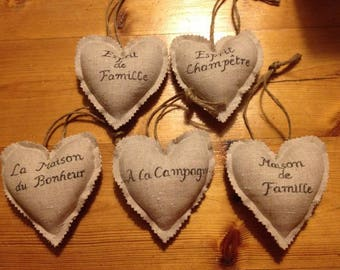 Little hearts in linen with inscription