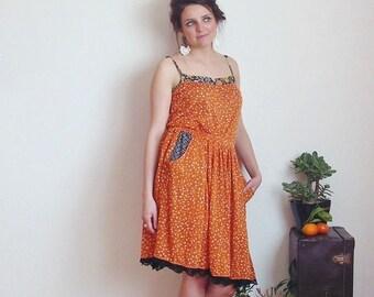 """Naranja"" fine white lace leaf pattern orange mesh skirt black"
