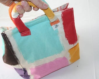 Bag Lunch like Mondrian ideal for carrying her picnic lunch or a small snack