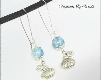 Lever back earrings with Pearl effect blue wave and a charm in the shape of perfume