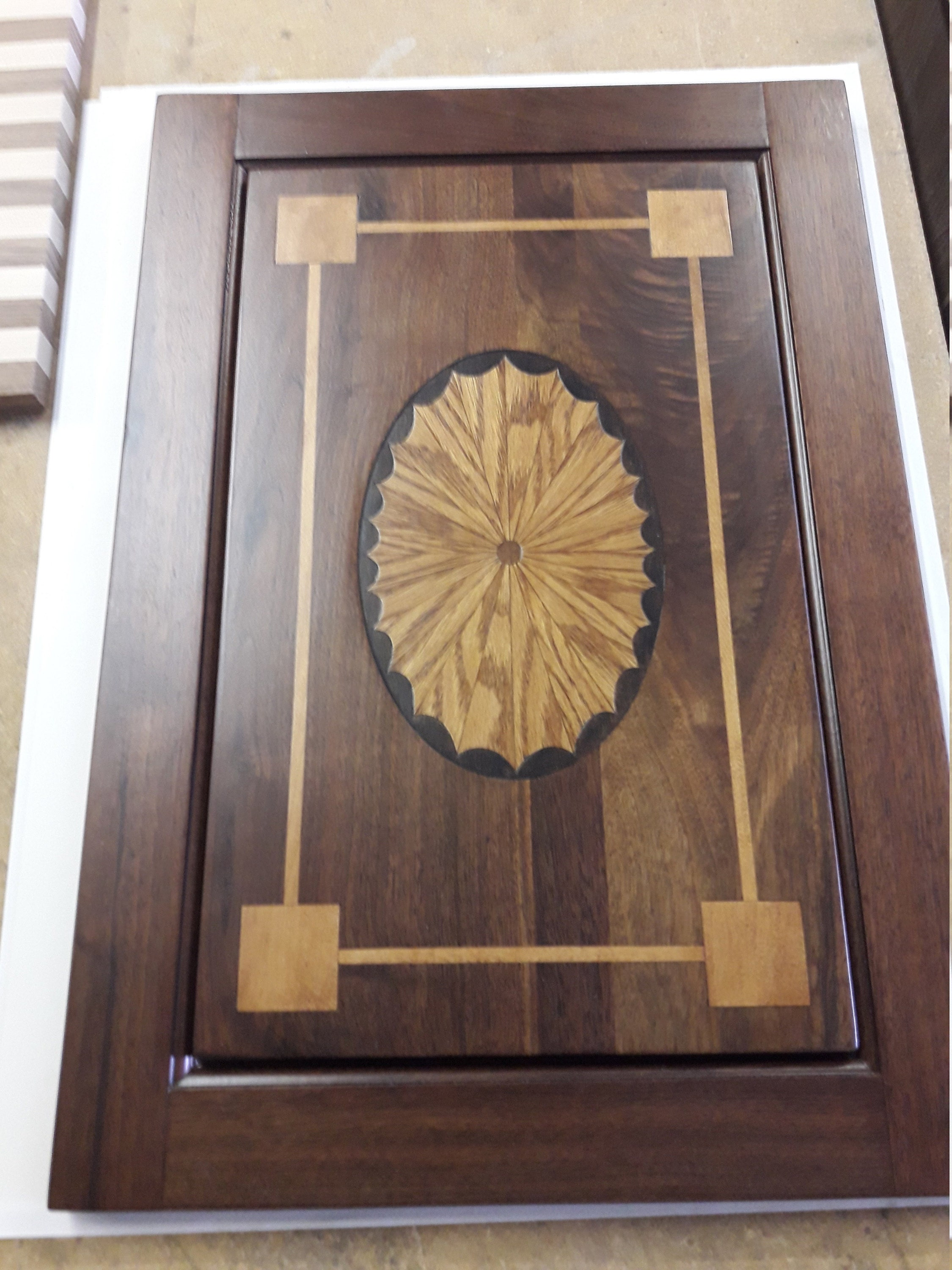 walnut console door with sunburst inlay