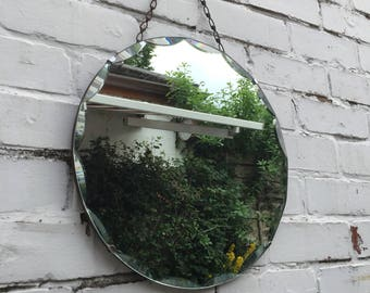 Lovely Round scoloped mirror with lovely hanging chain!