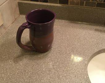 Large purple and brown pottery mug