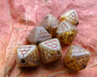 7 Czech bicone beads - beige tone accented with a finish rust (slightly translucent) geometric patterns - 12 mm