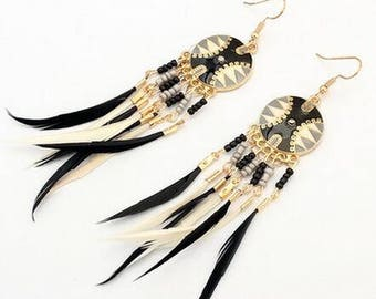 earrings with small black and white feathers