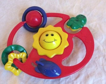 On Sale Vintage multi coloured, multi activity rattle. Stroller/crib/car seat toy.