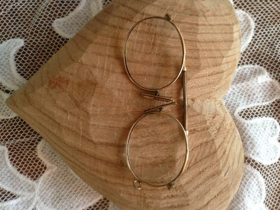 Pair edwardian spectacles. Lengthening bar between lenses