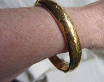 Vintage rolled gold bangle, half engraved, safety chain. Traditional 9ct gold filled metal core bracelet