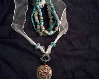 Terquoise and copper necklace and beaded bracelet set.