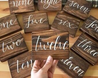 Rustic wood table numbers // rustic wedding // rustic wedding decor // wedding signs // wood signs // table numbers // table numbers wedding