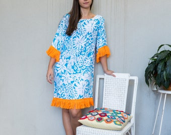 Retro shift dress.  Floral turquoise print with orange yarn fringe.