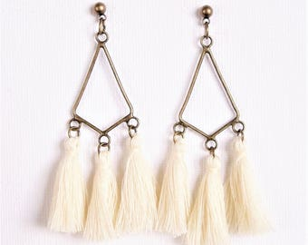 White tassel and chandelier earrings