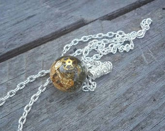 Resin sphere pendant with gears and golden leaves