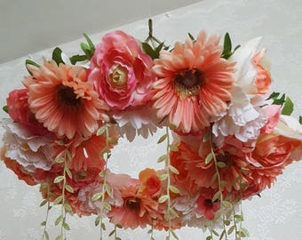 Coral and peach wreath mobile with vines