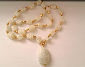 white scarab beetle necklace