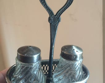 Vintage salt and pepper shakers . Antique salt and pepper shakers