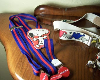 Vintage children's Snoopy suspender and three more pairs of different vintage suspenders for kids.