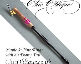 Oblique pen holder, Stabilised Maple with two Pink Pearlised Rings and an Ebony Wood Tail