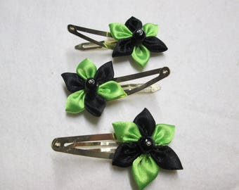 Metal hair clip with a satin flower