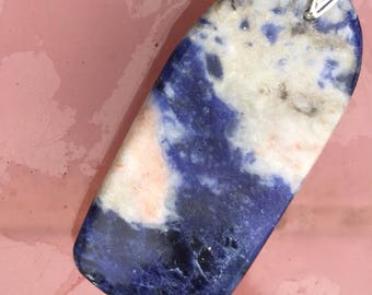 Stunning natural sodalite pendant with unique marking, hand carved in Scotland, complete with interchangeable sterling silver bail.