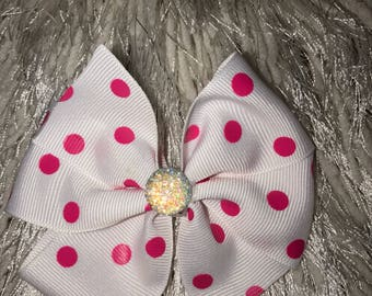 Pink and white polka dot hair bow on clip