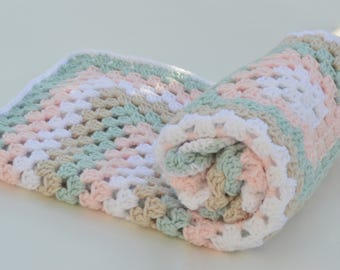 Pastel green and pink crochet  baby blanket