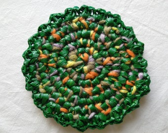 Recycling, place mat, bottle, trinkets, crocheted bi material below upcycling