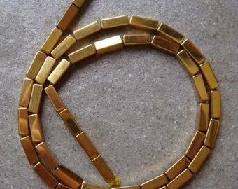 5 RECTANGLE 9 X 3 MM GOLD HEMATITE BEADS.