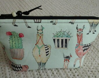 Llamas and cactus cosmetic pouch