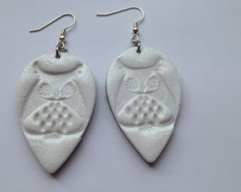 White dangle earrings in polymer clay