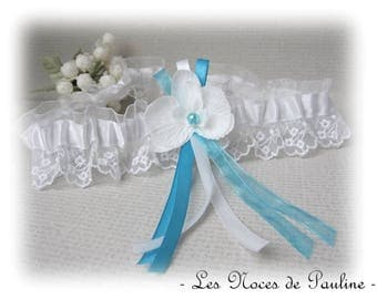 Has white and turquoise lace wedding garter