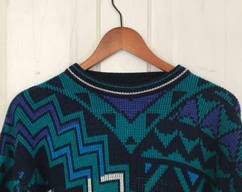 Funky geometric 80s neon blue sweater