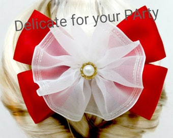 Delicate pearl hair bow