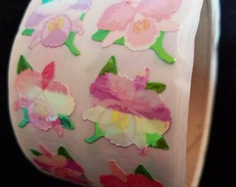 Plastic sticker roll with 50 breaks flowers