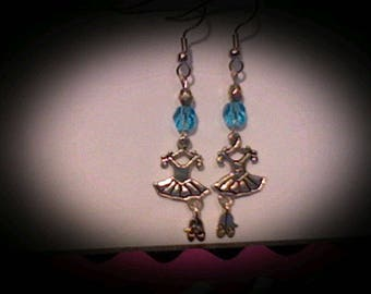 Ballerina earrings sliver charms w/turquoise bead accents.