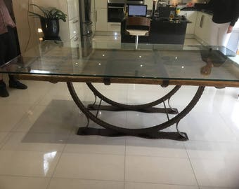 Dining table made from Middle Eastern doors with reinforced glass top and fabricated steel base. Handmade furniture. Dining room, home decor